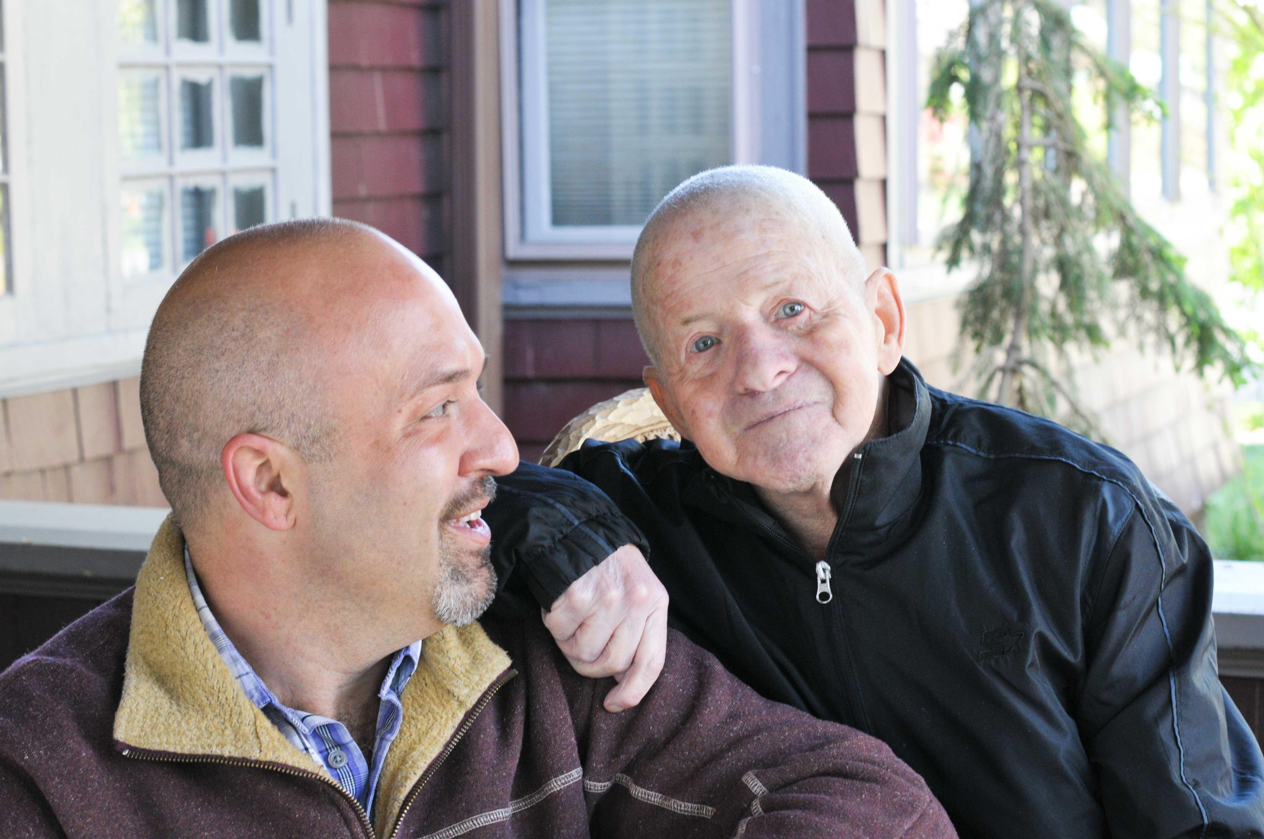 jerrod-looking-at-bill-looking-at-camera-on-porch